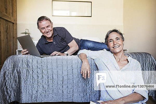 Portrait of happy senior couple in bedroom