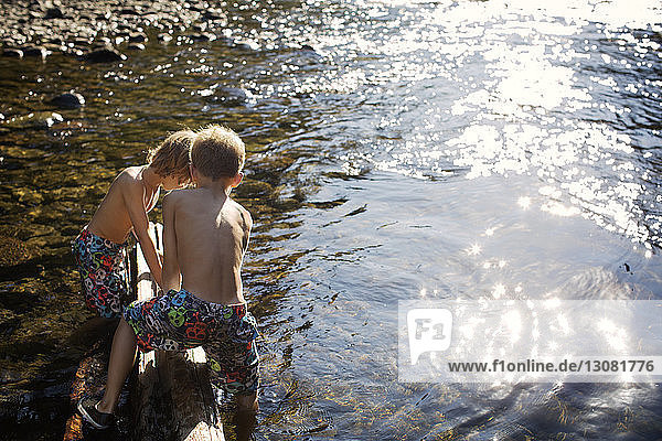 Boys playing by river