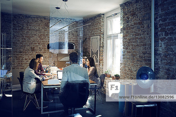 Business colleagues in meeting at conference table