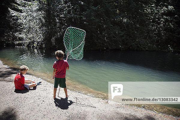 Boys fishing in river
