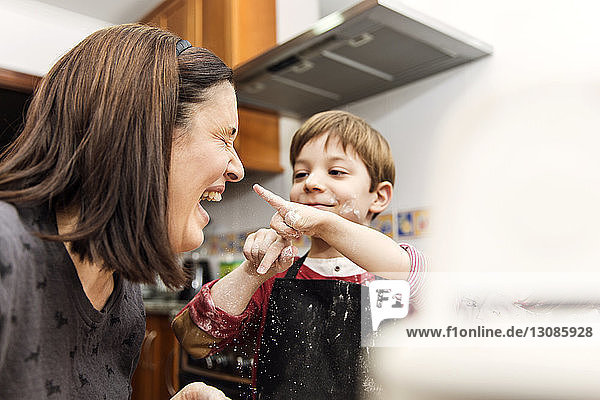 Mother and Son Laughing while cooking together