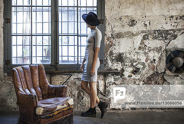 Thoughtful businesswoman standing by window at workshop