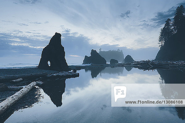 Scenic view of rock formations at Ruby Beach against sky