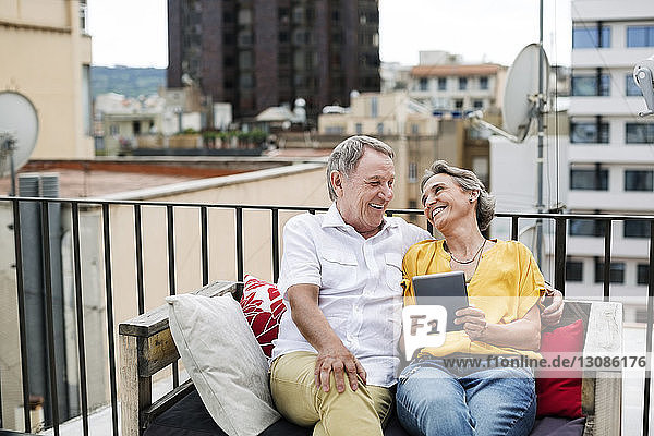 Cheerful senior couple spending leisure time on terrace