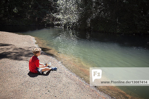 Boy fishing in river