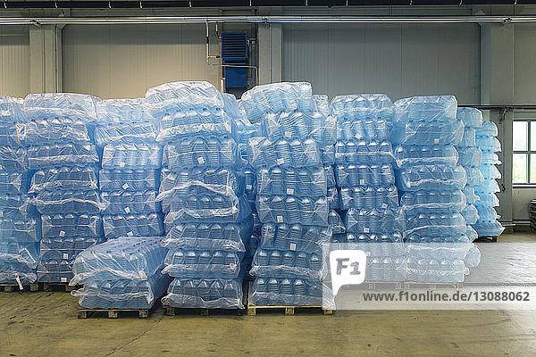 Pallets of water bottles in warehouse