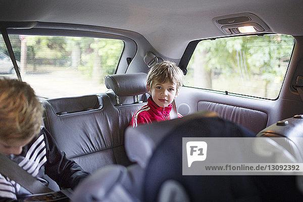 Two boys sitting in car