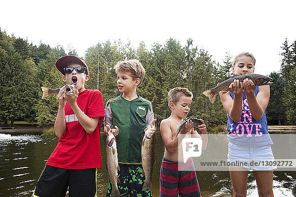 Children holding fish