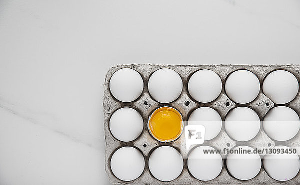 Overhead view of egg carton on table