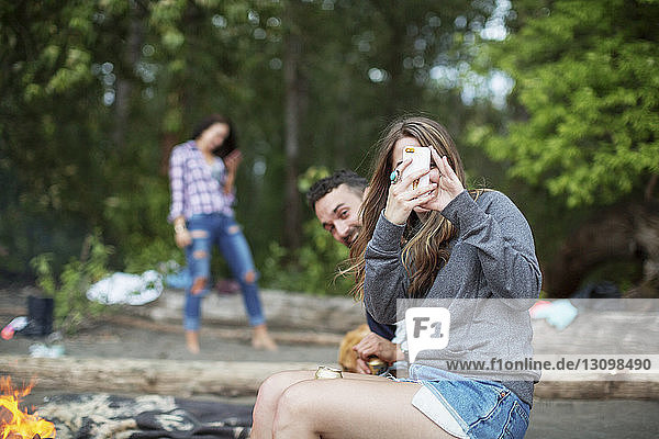 Friends enjoying at riverbank