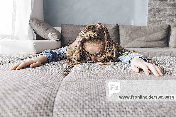 Portrait of girl relaxing on bed at home