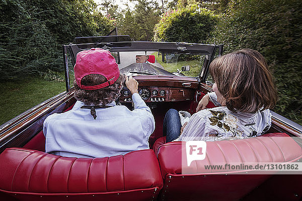 Rear view of senior couple sitting in car