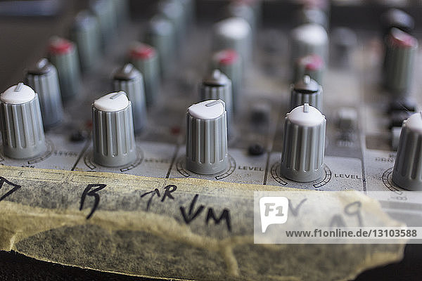Close up sound mixer dials with taped markings
