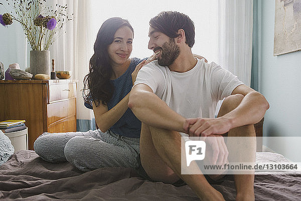 Portrait couple relaxing on bed