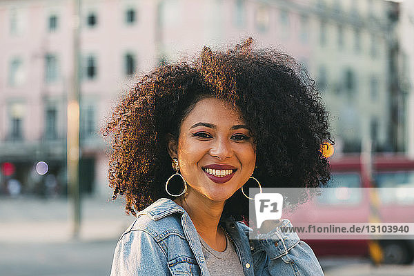 Portrait smiling  confident young woman on urban street