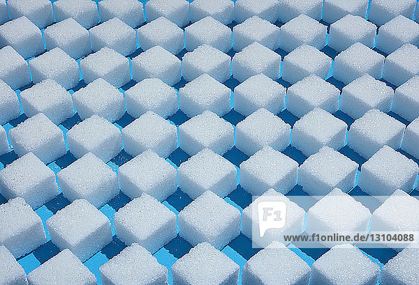 Full frame sugar cube checkered pattern on blue background