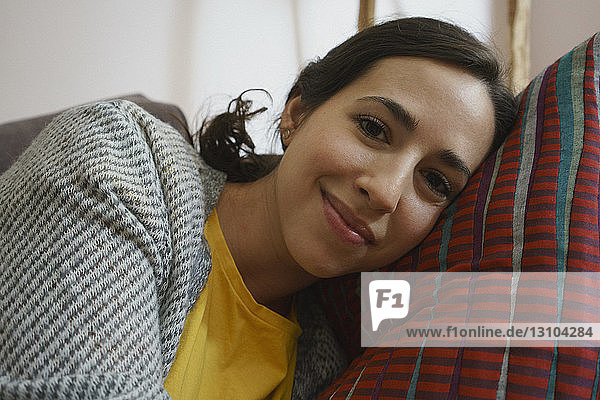 Portrait smiling woman relaxing  laying on pillow