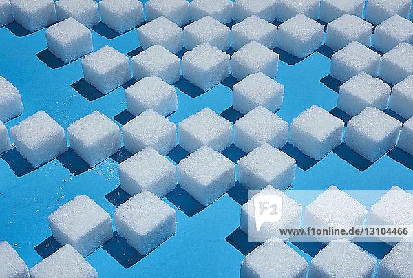 Sugar cube pattern on blue background