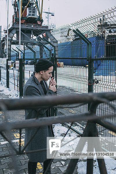 Shipyard worker smoking