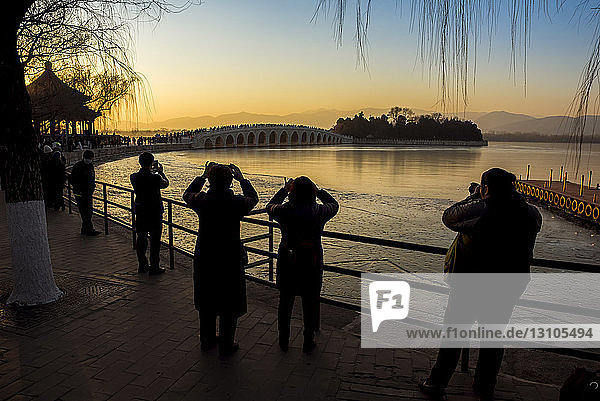 Sunset over Kunming Lake and the 17 Arch Bridge  The Summer Palace; Beijing  China