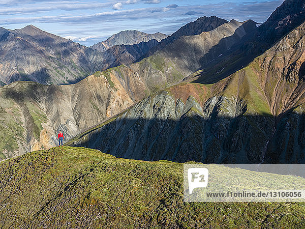 Woman exploring the rugged mountains of Kluane National Park and Reserve; Haines Junction  Yukon  Canada