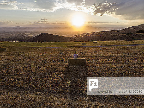 Looking out to a vast farming landscape at sunset; Hyde Park  Utah  United States of America