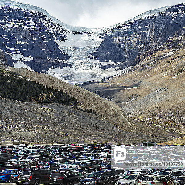 A full parking lot in Jasper National Park with a glacier in the Rocky Mountains; Alberta  Canada