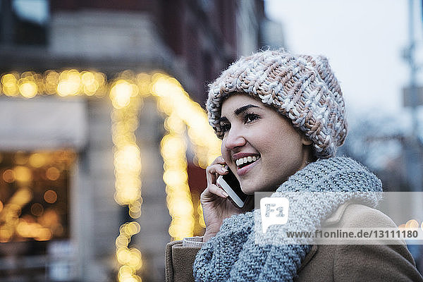 Close-up of happy woman talking on mobile phone
