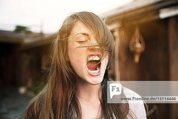 Woman screaming at backyard