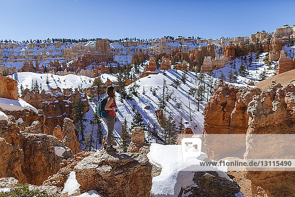 Side view of hiker standing on mountain against clear sky at Bryce Canyon National Park