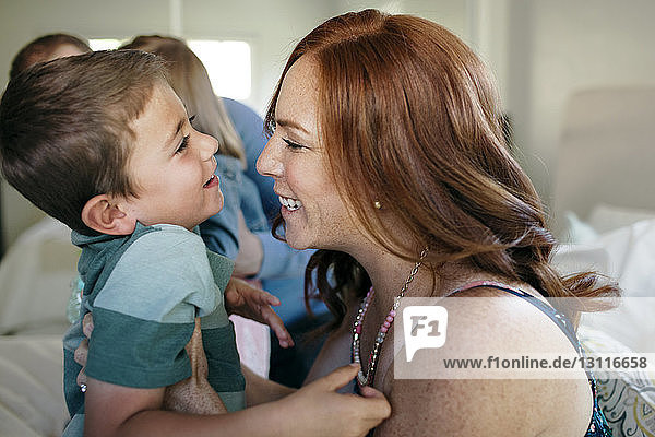 Cheerful mother and son enjoying at home
