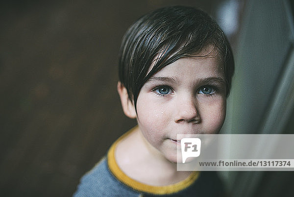High angle portrait of confident boy at home