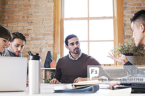 Business people at desk during meeting in office