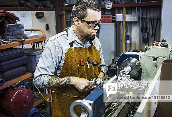 Mechanic working on machinery in auto repair shop