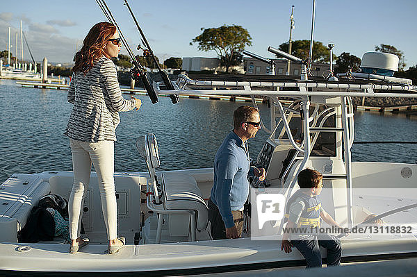 Family traveling in boat on sunny day