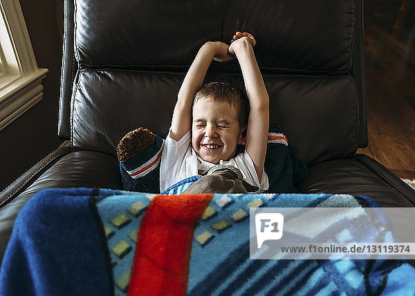 Boy waking up in armchair
