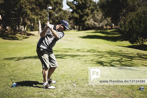 Golfer playing on field at golf club