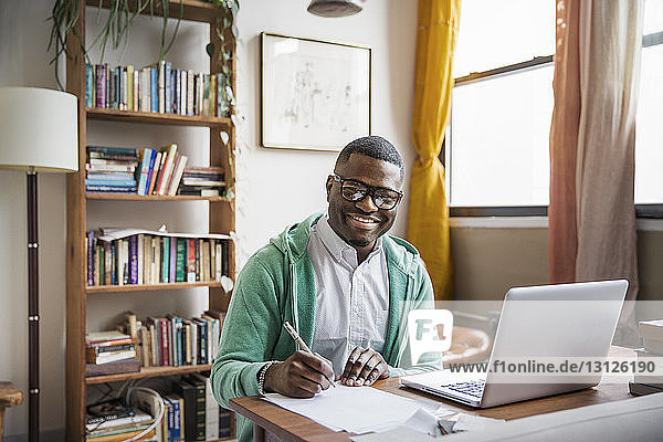Portrait of happy man working at home