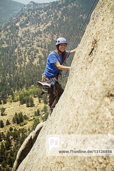 Portrait of hiker climbing mountain
