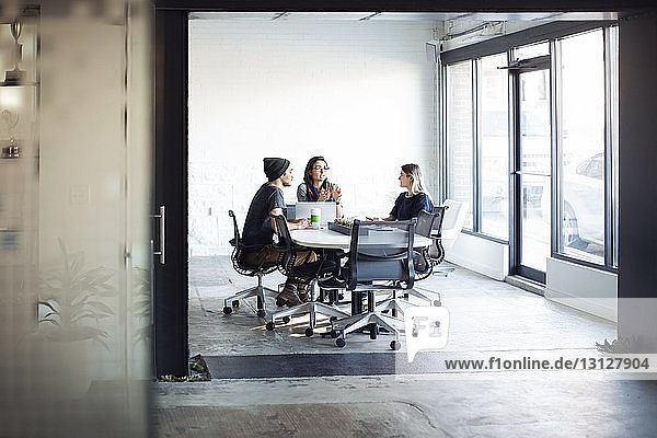 Business people discussing in meeting at creative office