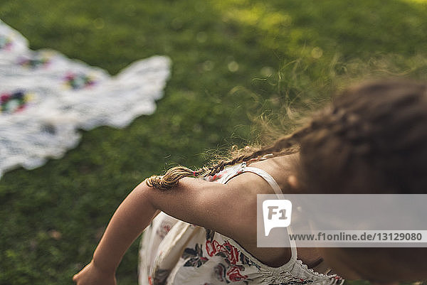 Close-up of girl playing on field at park