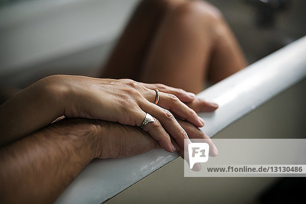 Cropped image of romantic couple in bathtub at home