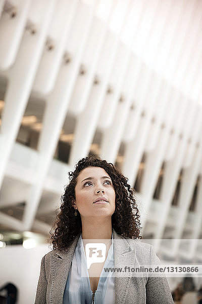 Thoughtful businesswoman in modern building