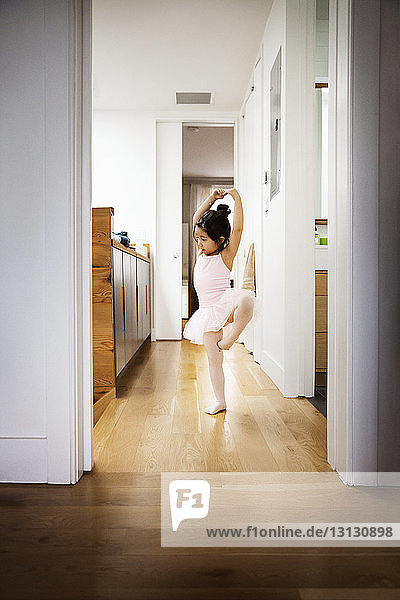 Girl practicing ballet at home