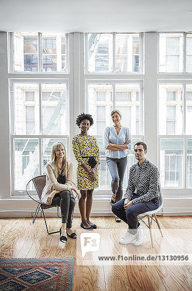 Portrait of confident business team in creative office