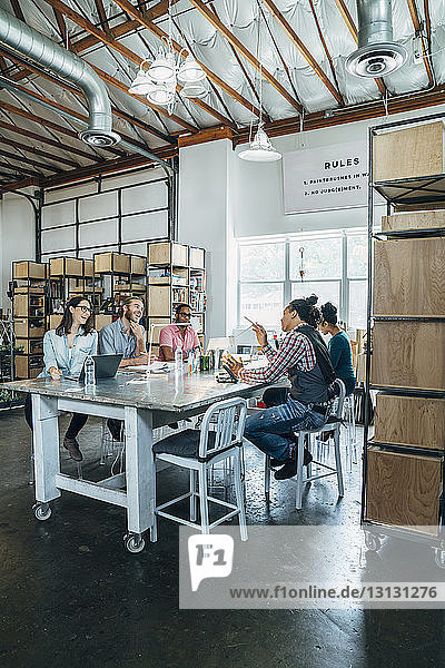 Business people having discussion at conference table in office