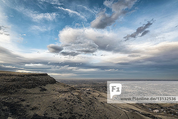 Scenic view of landscape against cloudy sky at Denver