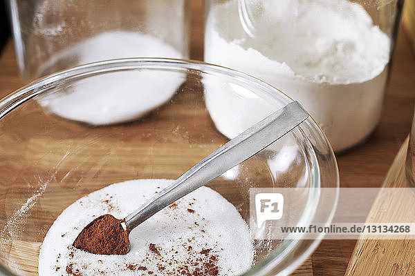 Close-up of cocoa powder and flour in bowl on table