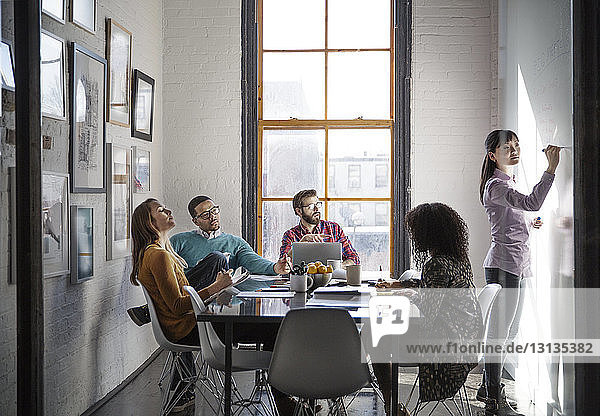 Business people discussing during meeting in creative office