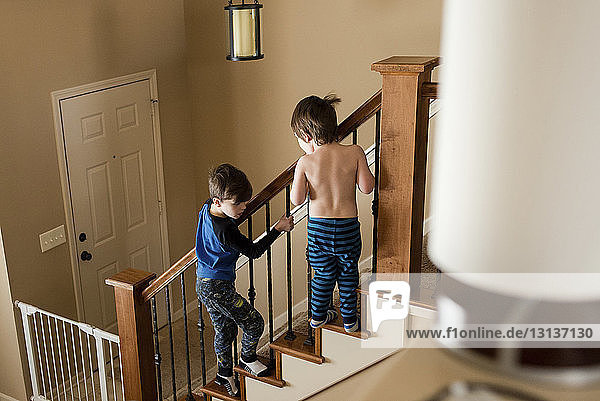 Playful brothers at edge of staircase